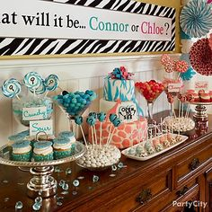 Wild & wonderful safari baby shower dessert table with a gender-reveal theme ... Rarr!