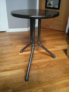 Industrial style table with black steel pipe legs.  The Worthy Gentleman - Etsy