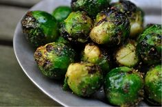 "Grilled Brussels Sprouts: ""Brussels sprouts get a spring makeover, and a healthy amount of smoke, by being thrown on the grill. Quickly tossed in oil seasoned with garlic, celery salt, and onion, they're charred only long enough to let the fire wake up their flavors."""