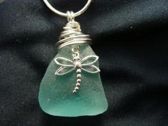 A beautiful piece of sea glass with a  sterling silver dragonfly charm, wire wrapped and hung from a .925 silver snake chain  http://www.zibbet.com/SeaJewels/artwork?artworkId=1041614