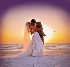 Wedding couple kissing on the beach at the Clearwater Beach Sandpearl Resort. #BeachWedding #Couple #Kiss