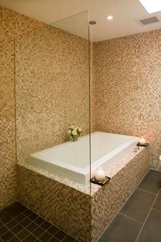 Tile is everything in this bathroom! We love the graphic look of this relaxation nook with out Origami Original Series. See all the collection here : http://www.bainultra.com/therapeutic-baths/our-collections/origami/origami-7236-original-series