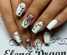 Sizzling White and Red Combo. White when coupled with red gives a sizzling hot combo, that cannot be resisted by anyone. Try this nail art and you'll agree.