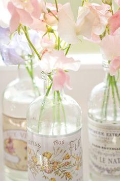 pink flowers in bottles