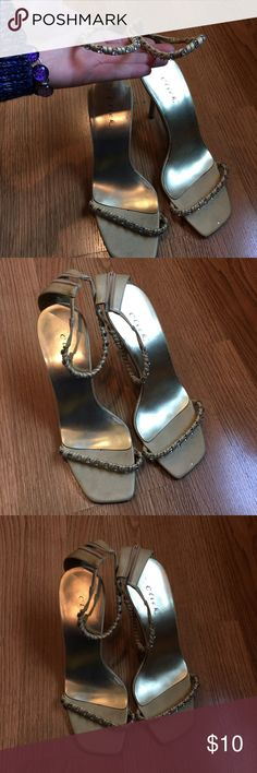 Click strappy tan heels w silver gems 💎 Click strappy tan Vegan leather heels w silver gems 💎 gold interior. Size 7. Worn only once. click Shoes Heels
