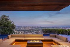 A covered seating area with a fire pit at the center extends above the pool Casa Top, Los Angeles Skyline, Indoor Waterfall, Casa Patio, Hillside House, House Viewing, Los Angeles Homes, Pool Designs, Outdoor Spaces