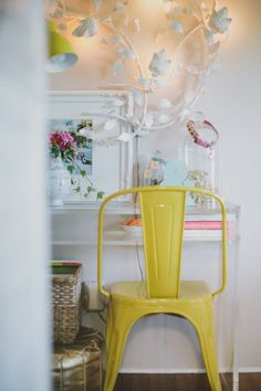 I love a sunny yellow. It's the Californian in me. We have our vintage Mexican wedding cake toppers in one of those glass domes, and the col...