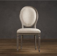 RH's Vintage French Round Fabric Side Chair:Our reproductions of vintage French dining chairs display the elegant restraint emblematic of neoclassicism. Defined by linear form and tapering fluted columnar legs, the chairs have been updated in hand-carved oak with a soft, weathered finish.