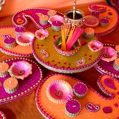 Beautiful pink and orange Mehndi plates with matching oil pot. See my Facebook page for more ideas and inspiration www.facebook.com/mehnditraysforfun