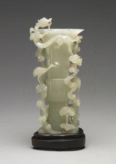 Jade Gu-shaped Vase with dragon-in-the-cloud and divine-crane motif, mid Qing dynasty, 1736-1820 AD.