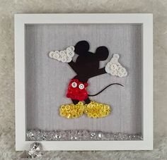 I am proud to introduce my latest addition to my range Mickey Mouse Mickey is a silhouette figure and dressed with high quality buttons and finished off with tiny diamanté stones to add that extra sparkle. The bottom off the frame is decorated with acrylic crystal gems.