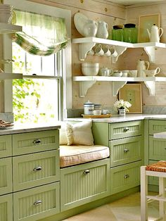 Window seat in the kitchen. #green #openshelves