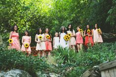 Bridesmaids dresses, different dresses and shades of coral with sunflowers @Hanna Lee