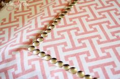 fabric and thumbtack covered cork board... so easy, I'm doing this!