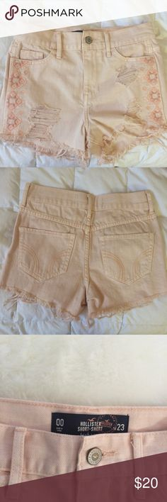 NEVER WORN Hollister Shorts BRAND NEW NEVER WORN Hi-Rise Hollister shorts in size 00/23. Super cute embroidery and distressing! Also a very high quality and comfy fabric in a peach color. These are a great pair of summer shorts!☀️❤️ Hollister Shorts Jean Shorts