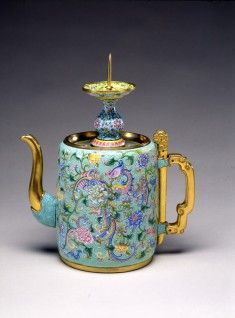 """The mythical """"feng"""" (phoenix) is entwined with scrolling peonies on the surface of the teapot. Furthermore, a few little zoomorphs-- possibly phoenix chicks --also sail across the space. The element of the bizarre in this conception is of a different order from anything seen in earlier Chinese art-- even in archaic bronzes.  Of course the imagery on the teapot does have a traditional aspect. The Chinese character for phoenix, symbol of the empress in Qing [Ch'ing] times, has bee..."""