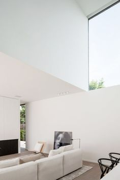 Double height ceiling accented by large minimal window. designer unknown