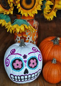Check out this sugar skull pumpkin design that will be a hit this Halloween.