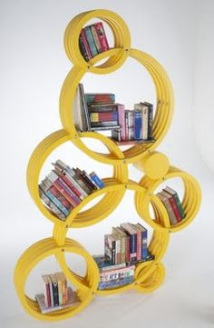 Bookshelf: Circus shelving.  Wow that's unique. May try to make one with hat boxes. Could leave back of the boxes on and paint them.