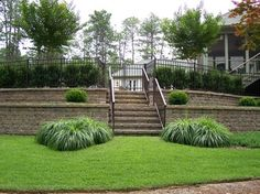 fence at top of tiered retaining wall