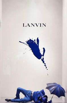 LANVIN splash windows aug Could we use this as inspiration for a colour discussion in a new fashion book? I'd love a couple of lines about the feeling blue inspires, then a whole load of white space to allow the blue splash to make an impact. Visual Merchandising, Fashion Merchandising, Window Display Design, Store Window Displays, Retail Displays, Shop Displays, Retail Windows, Store Windows, Propaganda Visual