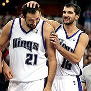 Vlade Divac and Peja Stojakovic. Back when the Kings were good! I miss those days!
