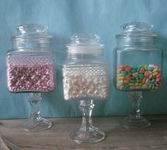 DIY apothecary jars. You can achieve this without breaking by using jars, vases and candlestick holders from the Dollar Store or from your local thrift store.