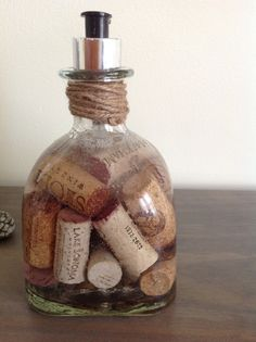 Now, I know how come I haven't seen this idea around.... The corks FLOAT, not quite the thought I had. I thought the corks would of swelled a little, taking up some of the space. But instead I had empty space at the bottom. Well, since that didn't work out the way I thought it would. I just shoved in more corks. I like it, it's neat looking. I think she'll like it.