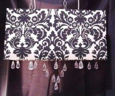 Black and white damask rectangle shade with suspended crystals.