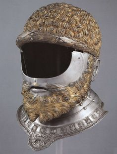 Steel and gold helmet, a creation of Filippo Negroli c. 1533, for Charles V. (Royal Armory, Madrid)
