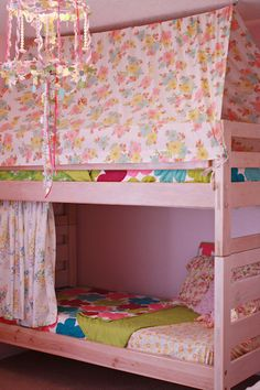 awesome girls' bedroom with a bunk bed tent