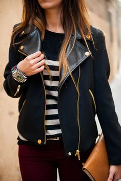 maroon pants, black moto jacket, black and white stripes under