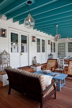 House of Turquoise: RS Custom Homes - so much to love on this porch!  Lighting - blue ceiling etc!