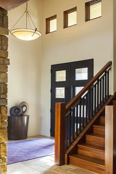 New Waterfront Home - modern - entry - austin - Dawn Hearn Interior Design Entry Hallway, Entry Doors, Stair Banister, Austin Homes, Austin Texas, Modern Entry, Hallway Lighting, Transitional House, Waterfront Homes