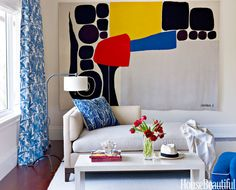 A wall-size Alexander Calder tapestry brings major color into a Naples, Florida living room designed by Robert Couturier. - House Beautiful - Contemporary Art - Dramatic Paintings - 2014 Home Decor Trend