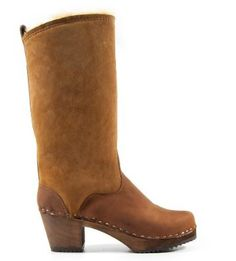 Sandgrens Women's SEATTLE SHEARLING MID Swedish Clog Boots Now for 299.00. shearling leather. Staples. Wooden base. Handmade in Sweden. Fit: Small in sizes, please choose one to one and a half size larger than you normally wear.