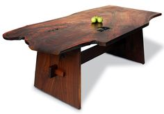 The Wells Table is a wood slab dining table. This table's top is made from a single board of highly figured Walnut. Base is composed of two large slabs of Walnut set at a 15-degree angle and connected by a center stretcher with through-tenons and...