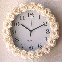 Buy a cheap clock, use hot glue and fabric/flowers to decorate!