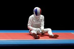 Out of the medals:    Lauren Rembi of France reacts after losing a bronze-medal match against Sun Yiwen of China in women's individual epee fencing Aug. 6.