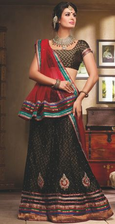 Design And Style And Trend Would Be At The Peak Of Your Elegance Once You Dresses This Net Lehnga Choli. The Lace Work,Patch Work,Resham Work,Stone Work, Looks Chic And Perfect For Any Affair.