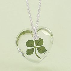 "$29.98 Silverplated 4 Leaf Clover Crystal Pendant 18in: It's the luck o' the Irish! Wear a real four-leaf clover and who knows what good fortune you'll find! Our pretty crystal-heart pendant with silverplated accents and chain holds a genuine clover sealed inside. Gift boxed. Pendant: 1"" long, 18"" chain."