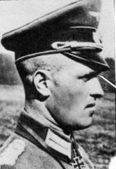 Generalmajor Heinrich Paul Hermann VOIGTSBERGER (10 February 1903 – 17 March 1959) captured by British troops in May 1945 and was released in 1947. Knight's Cross on 9 July 1941 as Major and commander of MG-Bataillon 2; 351st Oak Leaves on 9 December 1943 as Oberst and commander of Grenadier-Regiment 60 (mot.)