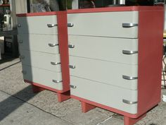 Pair of vintage, metal dressers with chrome pulls designed by Norman Bel Geddes for Simmons with original painted enamel finish.