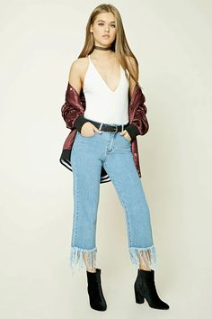 A pair of ankle jeans featuring a frayed hem, high-rise, wide-leg fit, a five-pocket construction, and a zip fly.
