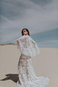 Sarah Seven. wedding dress. lace wedding dress. cape wedding dress. boho wedding dress. deep v wedding dress.