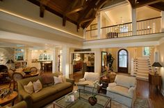 The Pros and Cons of Having an Open Floor Plan Home. Gorgeous open floor plan picture. I like the staircase landing overlooking the living room