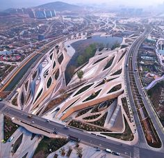 fluid diamond shaped complex carved into landscape by HDD_FUN architects