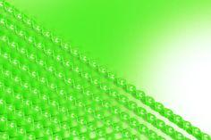 green plastic spiral sticks on green background