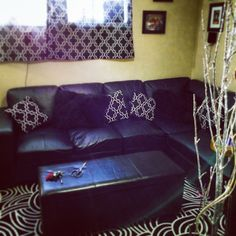 Brightened up my dark living room by adding a bold rug and curtain. Excess curtain fabric was used to make pillows.