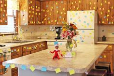 This is another EASY Elf on the Shelf idea (and was fun to do!) but made a BIG impact when the kids saw it! And it was super fun for them to race around collecting their color of post it note (not even realizing that they were cleaning it all up for us!). My husband also thought that using the larger size of post its would have been better. He thinks it would have made an even bigger impact…I guess that's just how men think! I think either would work well! To download, print or save the…
